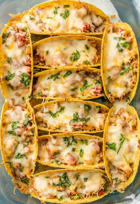 SUPER EASY Oven Baked Spicy Chicken Tacos make a weekly appearance on our table. All the flavor and none of the stress. ALL THAT MELTED CHEESE! Perfect recipe for a crowd on Family Mexican Night!