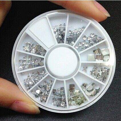 One Box Mixed Rhinestone Hot Sale Acrylic Nail Art Decoration Color: AS THE PICTURE Category: Beauty > Nails & Tools > Rhinestones & Decorations   Material: Acrylic  #wholesalenaildecoration #wholesaledecoration #naildecoration #decoration #bridgat.com