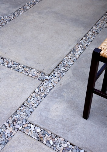 "The gravel is a mix between 3/8"" and 1/2"" Del Rio Gravel.   The pads are messa buff colored concrete with a sand finish."