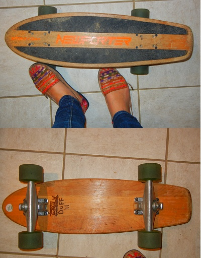 longboard trucks and wheels on a newporter skateboard