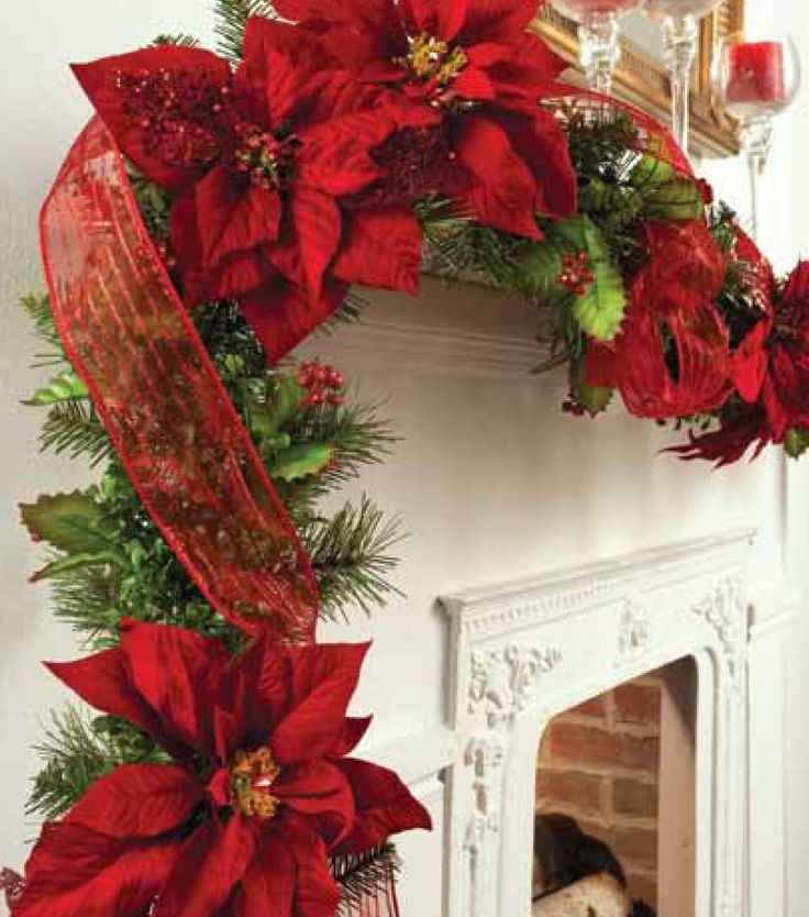 Decorate a mantel for the holidays with a festive poinsettia garland trim!