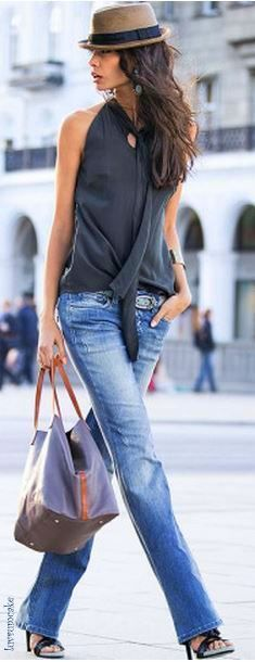 Street style. Jeans with black top and fedora.