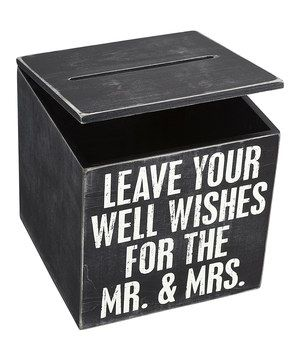 Toss out the guestbook and replace it with this whimsical box where guests can deposit their well wishes. The do-it-yourself look is perfect for a rustic or outdoor wedding.