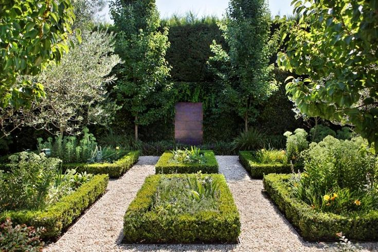 Plant-focussed parterre garden with water feature by Rudi Jass as a central focal point. Design Ian Barker Gardens Melbourne