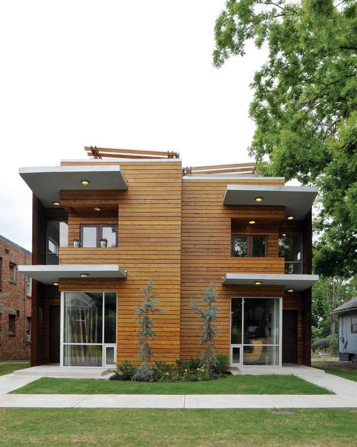 A deep green duplex makes the most of its urban lot and for Duplex apartment design