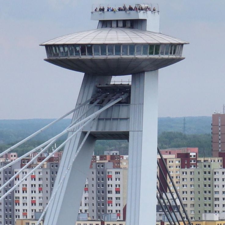 A zoomed shot of the #UFOBar #tower on #MostSNP in #Bratislava you can see the people on the observation deck above the bar. Most SNP is a #bridge that was built in 1972 which takes vehicles bicycles and pedestrians over the #River #Danube on two levels. It is the longest single pylon cable stayed bridge in the world. The UFO:Bar and observation deck above it give impressive views over Bratislava. #fact #slovakia #igersslovakia #igersbratislava #history #culture #education #travel #tourism…