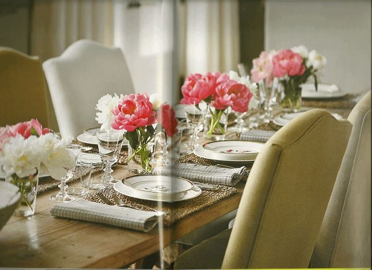 Dinner in the barn with pink and white peonies