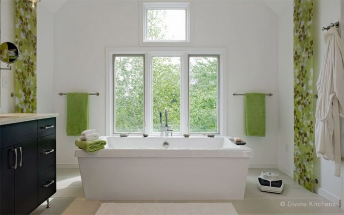 The fresh green Scandinavian retro print here matches the summertime view out the window. Note that this bathroom is completely black and white except for textiles and shower curtain, so the accent color can be easily changed any time.