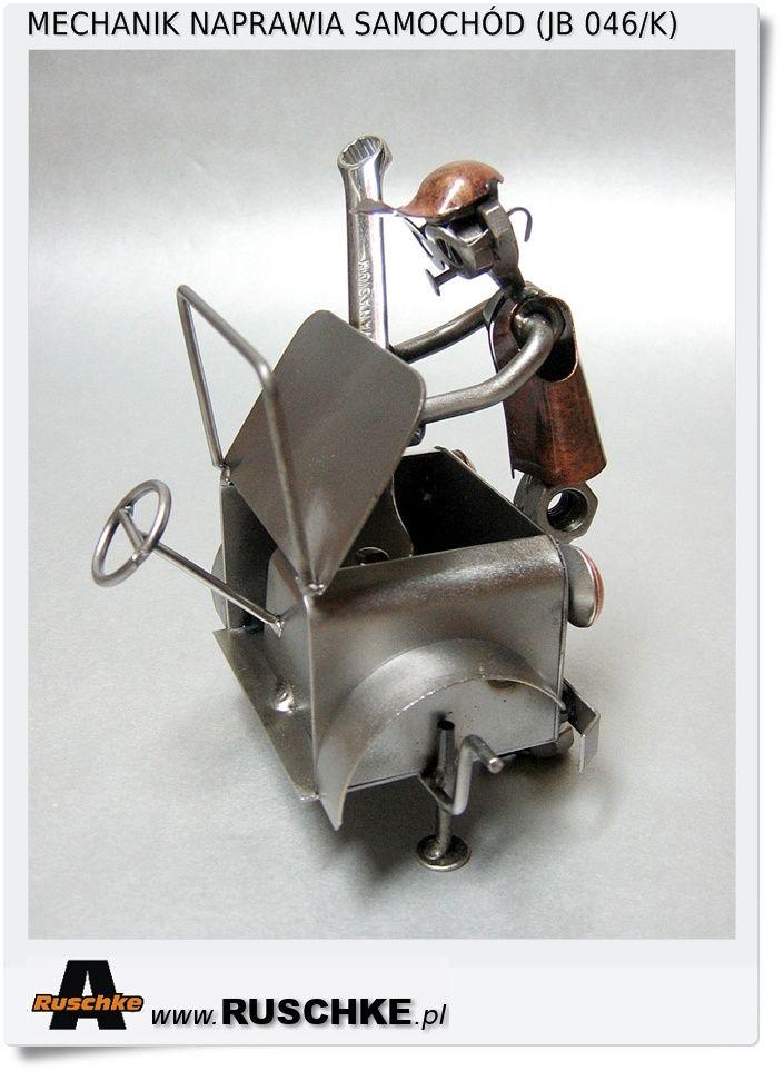 Mechanik naprawia auto Figurka mechanika na prezent