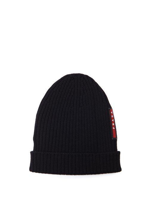 33b9cd6ea PRADA Logo-embellished ribbed-knit beanie hat. #prada # | Prada ...