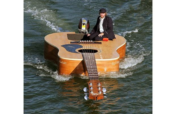 Australian singer Josh Pyke films a new video on a special boat created to the same specifications of the acoustic guitar that he usually performs with