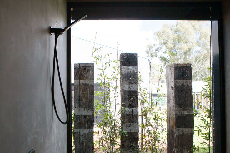 A stunning, natural light filled bathroom featuring Meir's Square Matte Black Portable Hand Shower on Bracket (MZ05) #MeirBlack #MeirAustralia #matteblack #blacktapware