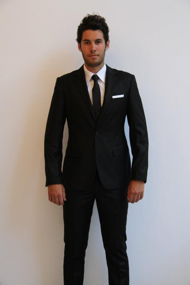 SuitCo slim shirt- $79  SuitCo Black slim tie- $49  SuitCo pocket hank- $19  Black SuitCo slim suit- $399