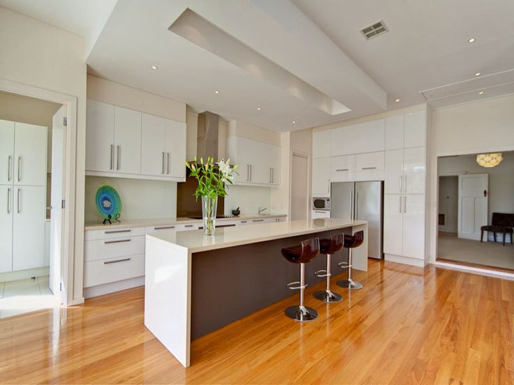 Modern island kitchen design using floorboards kitchen for Kitchen plans with island and pantry