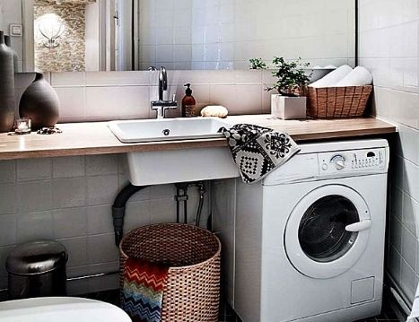 Laundry room utility sink. Beautiful wooden counter top. Place for Clothes dryer.