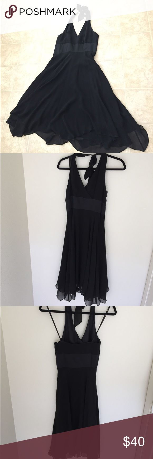 Donna Ricco semi-formal black silk dress. 6p This Donna Ricco black silk dress fastens halter style around the neck making it fully adjustable. It has threes layers of beautiful silk skirt for the perfect swish! 6p Donna Ricco Dresses Backless