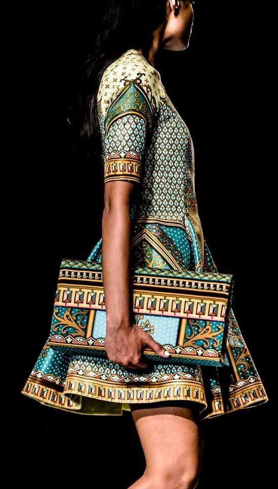 African print 50's dress with matching clutch.