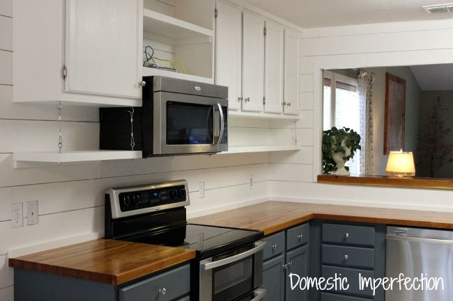Interesting semi-open shelving in kitchen. Put kitchen cabinets to the ceiling and add open shelving underneath.