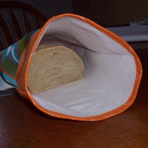 Easy Bread Bag - Some bread won't fit in your fridge or freezer, but you don't want to just leave on the counter either. Sew an Easy Bread Bag for a fun and sanitary way to store your bread. Check out the bag sewing tutorial to learn how to sew a bag that will keep all your homemade bread fresh. Bags like this are easy to make and you get to choose whichever fabrics you like best. Get started sewing this bread bag so you can keep your dinner germ-free.