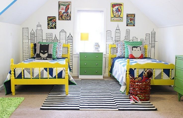 """Mallory's 3 boys begged for a room with """"Spiderman, Superman, Batman, Hulk and a chalkboard."""" To incorporate all that and still create a cute, charming, handmade room might seem like a tall order, but Mallory nailed it with this colorful and graphic bedroom, perfectly suited to please the whole family."""