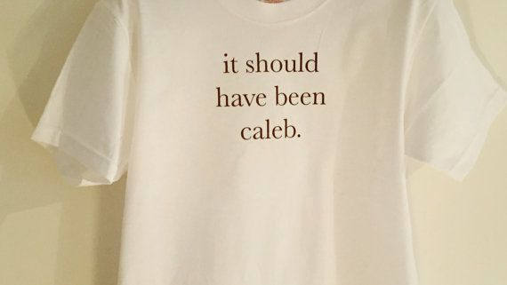 Divergent it should have been caleb T-shirt. Wash with your other white clothes Unsuitable for hand washing.  Small - UK 10  Medium - UK 12  Large