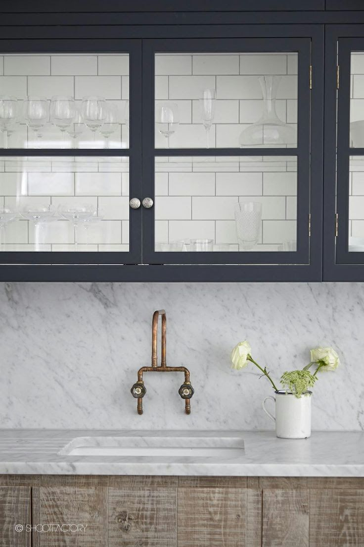 Industrial fixture for prep sink...subway tile detail in glass cabinets.  Blog: Honey & Fitz