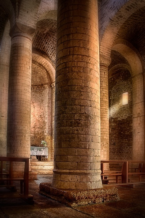 Near the incredible Frasassi caverns in the Le Marche region is the San Vittore Delle Chiuse Abbey. The light colored stones used on both the interior and exterior seem to have an inner glow when the sun streams in.  Italy Photos by Jim DeLutes   Jim DeLutes Photography -Various galleries including many Italy photos plus still lifes, scenics and lightning - JDLphotos.com