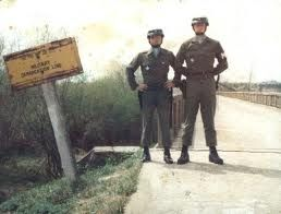"""Pictured here standing in front of the """"Bridge Of No Return"""", is PFC Robert Poorman and an ..."""