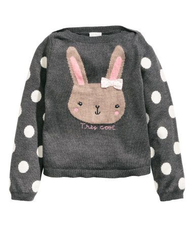 Fine-knit sweater in soft fabric with wool content. Motif at front and long sleeves.
