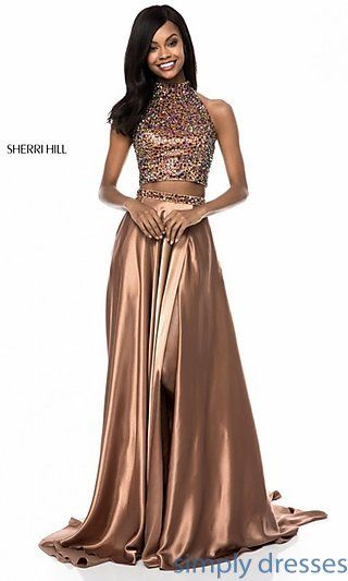 Shop two piece high neck floor length Sherri Hill gowns at Simply Dresses. Long prom dresses with beaded high necks and thigh high slits.