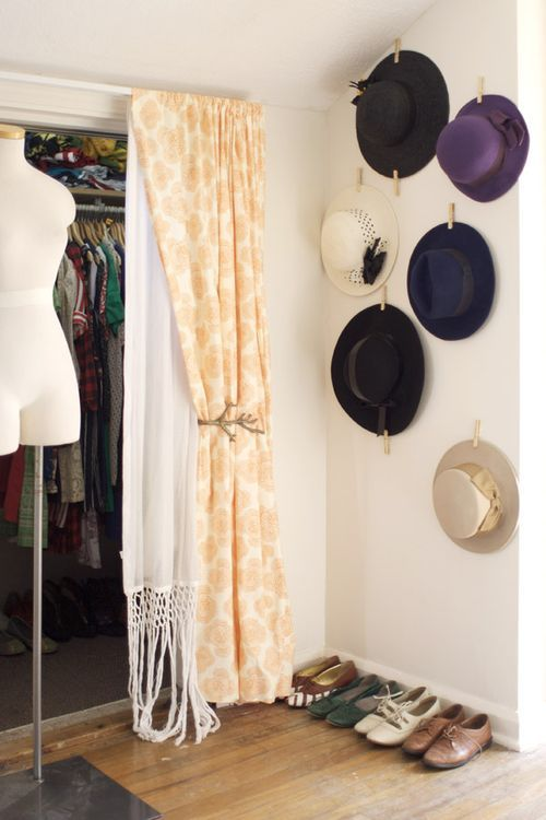 D.I.Y. Wall Decor Display for hanging hats - white sticky crafting squares and clothes pins, voila! 2 bucks later, a cute display of hats on the closet door.