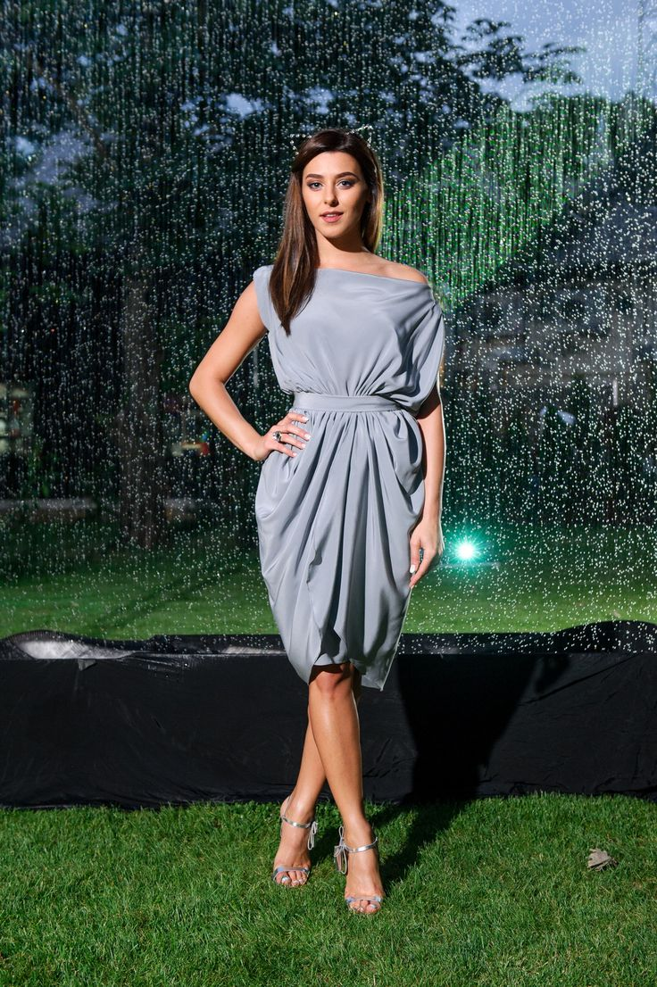 Patricia Cimpoiasu wearing http://shop.laurahincu.ro/product/office/blue-crepe-silk-draped-dress/