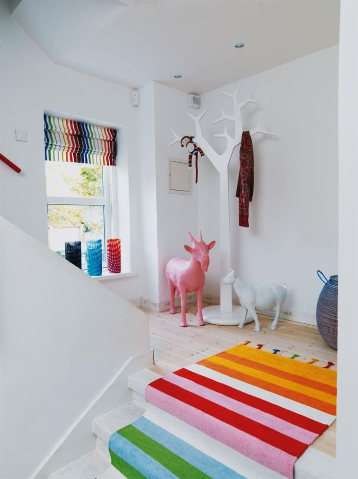 Colourful hallway | striped carpet