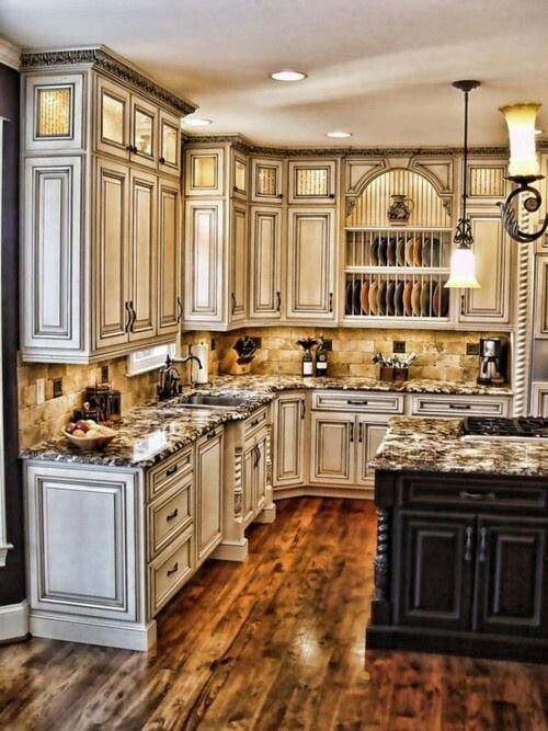 Kitchen. Paint-glaze, fancy cabinets with a black island. Love the glaze. The floors are beautiful, but I think super dark floors would look awesome with those cabinets.