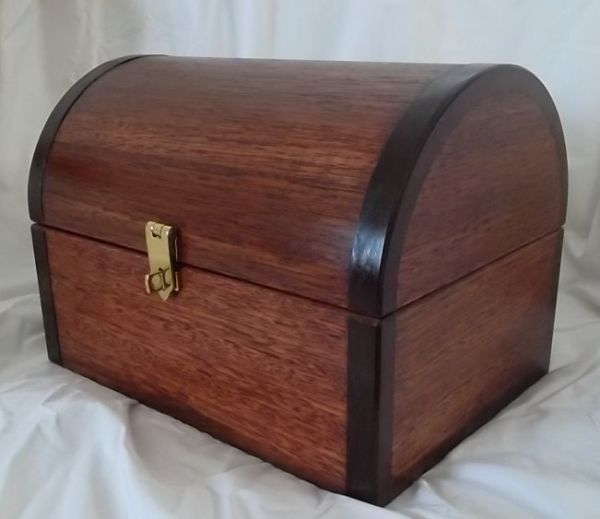 A large Jarrah chest with ebonized Jarrah banding for visual effect.  The box measures 320 x 230 x 230 mm.
