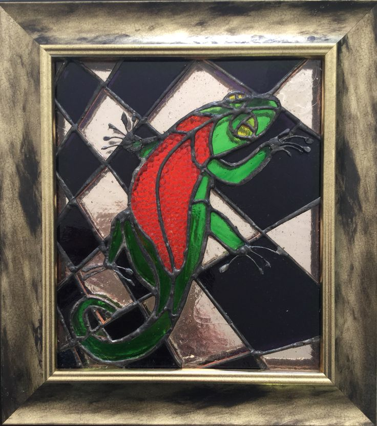 """Help Dad, there's a lizard in the bathroom"".  My daughter said this on holiday in South Africa. Actually it's a gecko captured in stained glass. It's presented with a mirror behind the artwork, this gives an exotic, glamorous look."