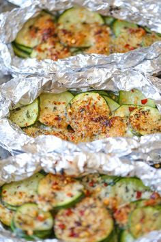 Zucchini Parmesan Foil Packets - A Favorite! Ohmygoodness! I made this on 7/7/17 and it is a keeper! I couldn't stop eating it. The only changes I made was that I cut my zucchini in thick slices and then quartered the slices. I used less butter and I baked it in the oven on 425°F. I also broiled it for a couple of minutes to brown the Parmesan. Soooo good!