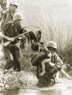Heroic and compassionate US soldiers saving Vietnamese children during the Vietnam War.