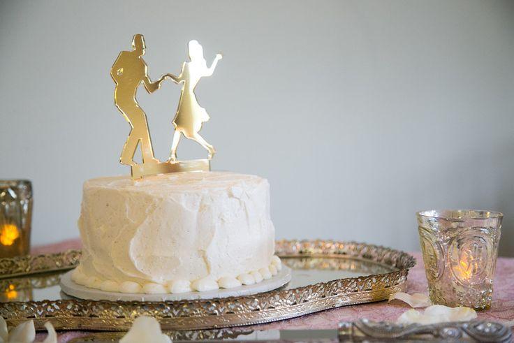 We love to swing dance! #weddingtopper #vintagegold #goldvotives #swingdance #wedding
