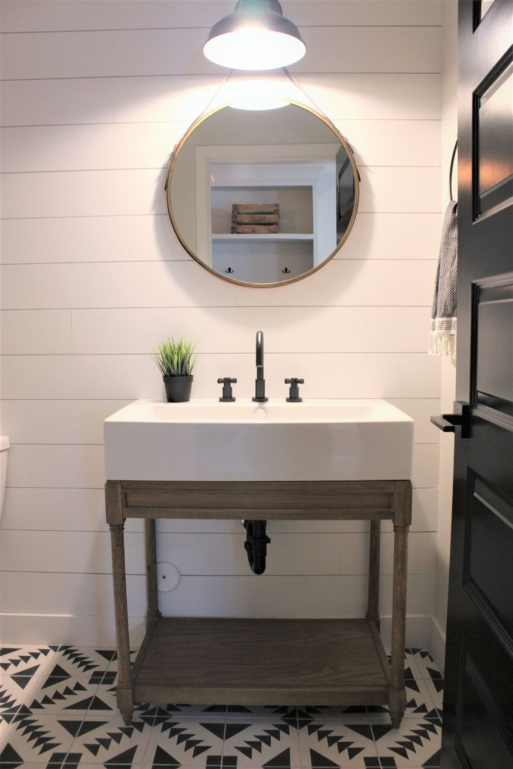 MODERN FARMHOUSE BY RAFTERHOUSE . SHIPLAP WALLS . POWDER ROOM . WOOD VANITY  . BLACK INTERIOR