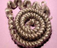 Light gray braided mohair.  http://barbspencerdolls.com
