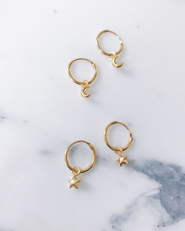 Gold stars and moons on an endless small hoop - Small hoop earrings that are perfect for stacking. Stylish, glam and fashionable - CLICK TO SHOP STAR MOON EAR HOOPS NOW.