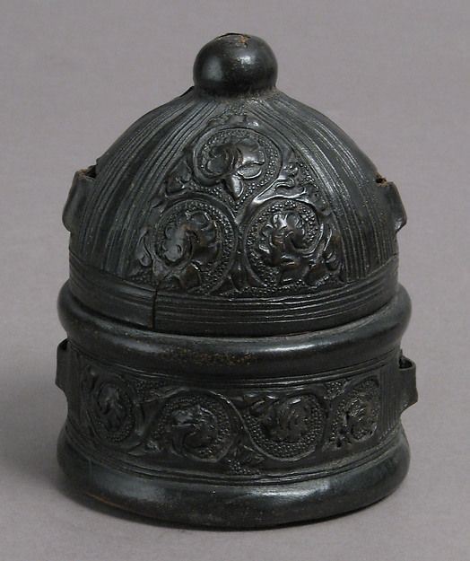 Box Date: 15th century Culture: Italian Medium: Leather (Cuir bouilli), on wood core with textile interior Dimensions: Overall: 3 9/16 x 2 7/8 x 2 3/4 in. (9 x 7.3 x 7 cm) Classification: Leatherwork