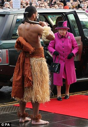 Oh my! The Queen looked taken aback as she was greeted by the topless men today...