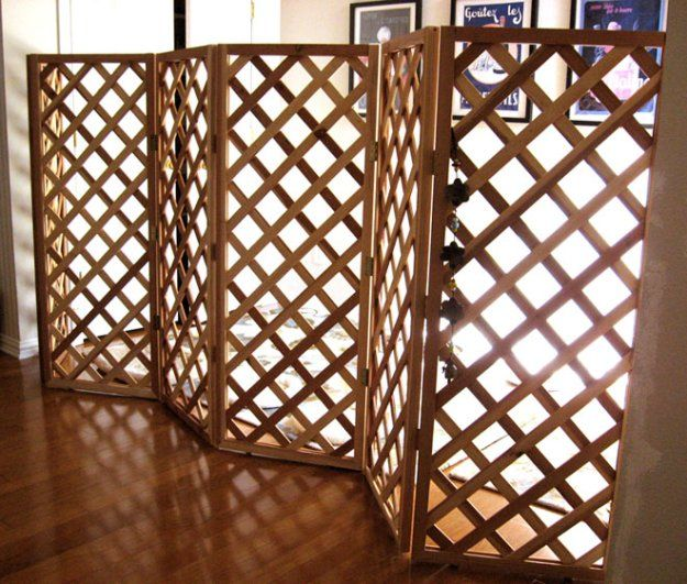 Use already made cedar trellis panels and hinges to create a DIY Indoor Pet Barrier.