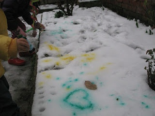 Snow painting with food colouring.