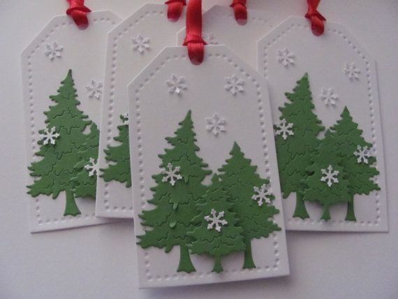 Christmas Tree Gift Tags, Christmas Tags, Christmas Favor Tags, Christmas Hang Tags, Holiday Gift Tags, Tree Gift Tags,Christmas Gift Tags.  This listing is for a set of 5 Christmas tree Gift Tags. These are great to dress up any holiday package, party favor, or gift basket.These gift tags are die cut from white card stock with die cut trees from green card stock with foam adhesive added to give that 3-D effect. Small snowflakes and red ribbon are added to for the finishing touches for…