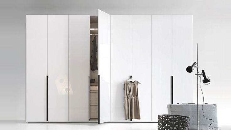 LEMA | FLAGO by Officinadesign Lema, is a custom closet that can be adapted in height, width and depth, also available for corner solutions. Wide-ranging internal equipment offers multiple combinations for any need of order: drawer units, display cases for trousers, belts and shoes. Shelf and hanging bar with built-in light.