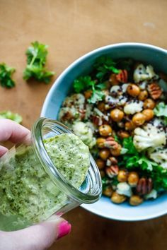 Baked chick peas and cauliflower in quinoasalat with jalapeno lime dressing - vegetarian food