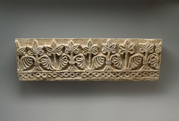 Wall frieze with row of leaves  Period:Sasanian Date:ca. 6th century A.D. Geography:Mesopotamia, Ctesiphon Culture:Sasanian Medium:Stucco Dimensions:6 3/4 x 4 1/4 x 22 in.